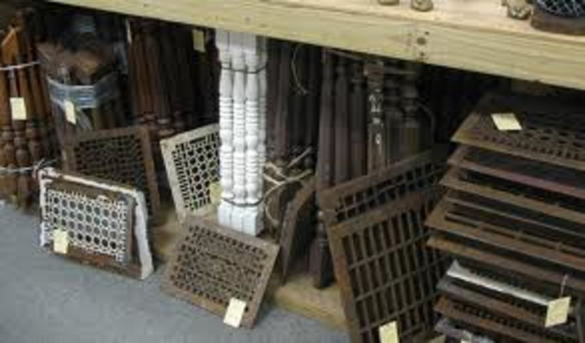 Old iron grates or heavy pieces of industrial type metal, often discarded, make great center pieces for a wall grouping.