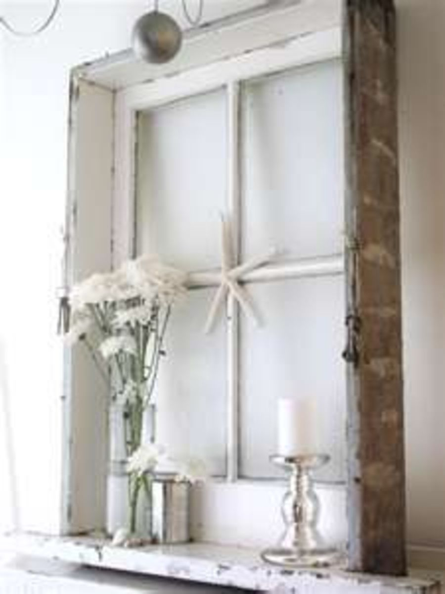 An old window still in the frame creates the perfect shadow box that can be filled with anything you find. It can be as simple as a basket of pine conss