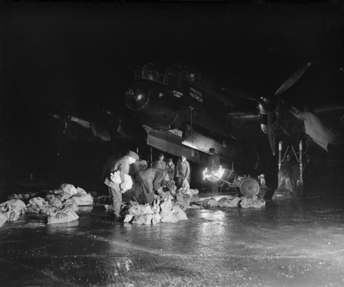 Loading a Lancaster at night with food