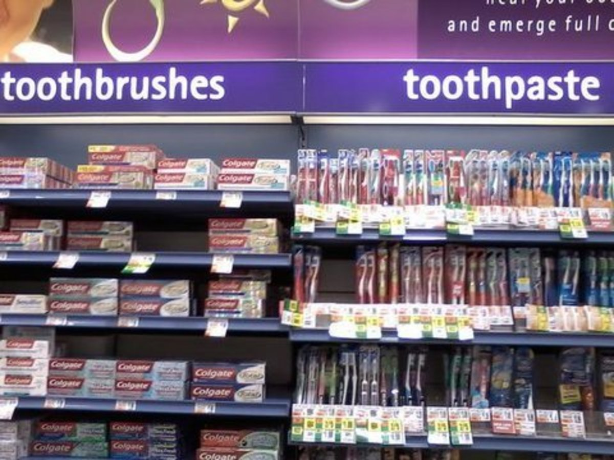 Someone's too lazy to categorize:  toothbrush in toothpaste rack and vice versa.
