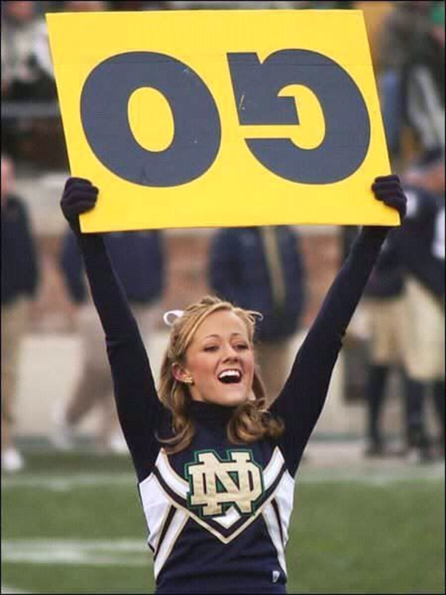 Forgive me for thinking in stereotypes, but she IS blonde, and that OG sign doesn't look too smart.