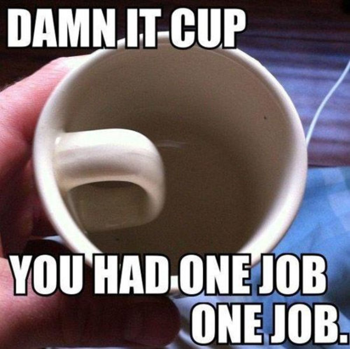 This has to be a joke, right?   A glitch with the mug machine or operator?  The whole reason behind having a cup, which is to drink fluid by holding the handle, just seems to have been overlooked.