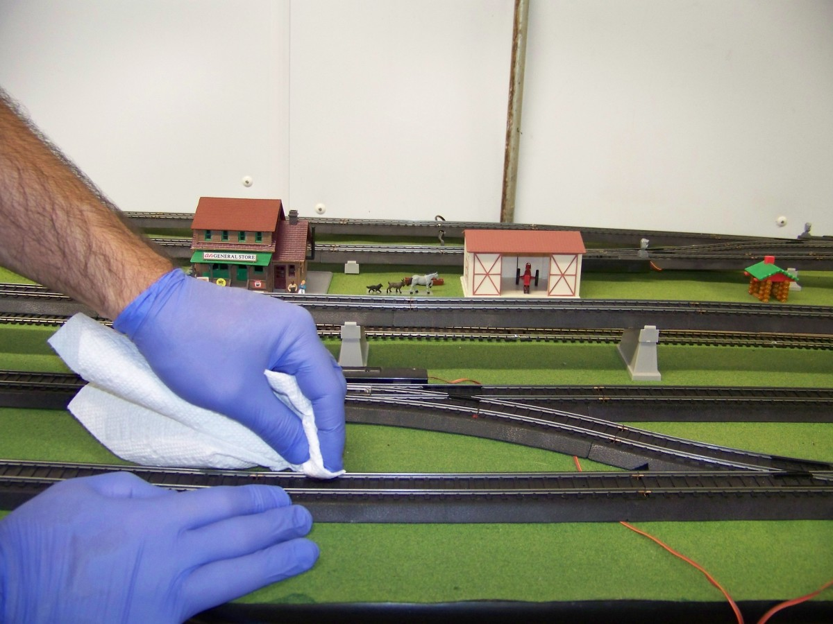 I then wipe the head of all rails with the Rail-Zip soaked paper towels making sure I remove all black deposits from the track head.   It takes me about an hour to do my 20 x 6 foot layout.