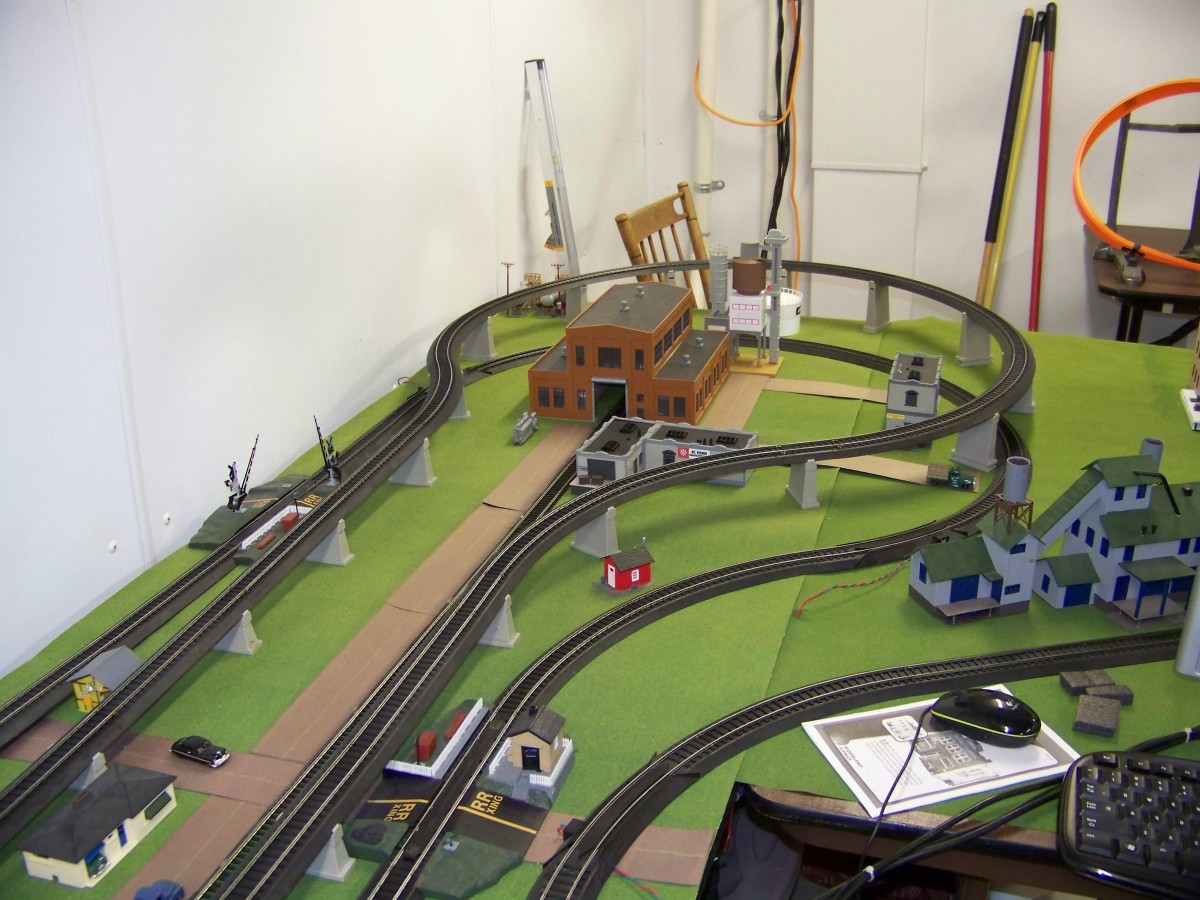 Can't fit the track layout you desire? Go vertical by using gradual trestles to lift part of the track. As you can see from the picture I wanted two loops but could not fit them in the allotted space, I elevated the inner loop with trestles.