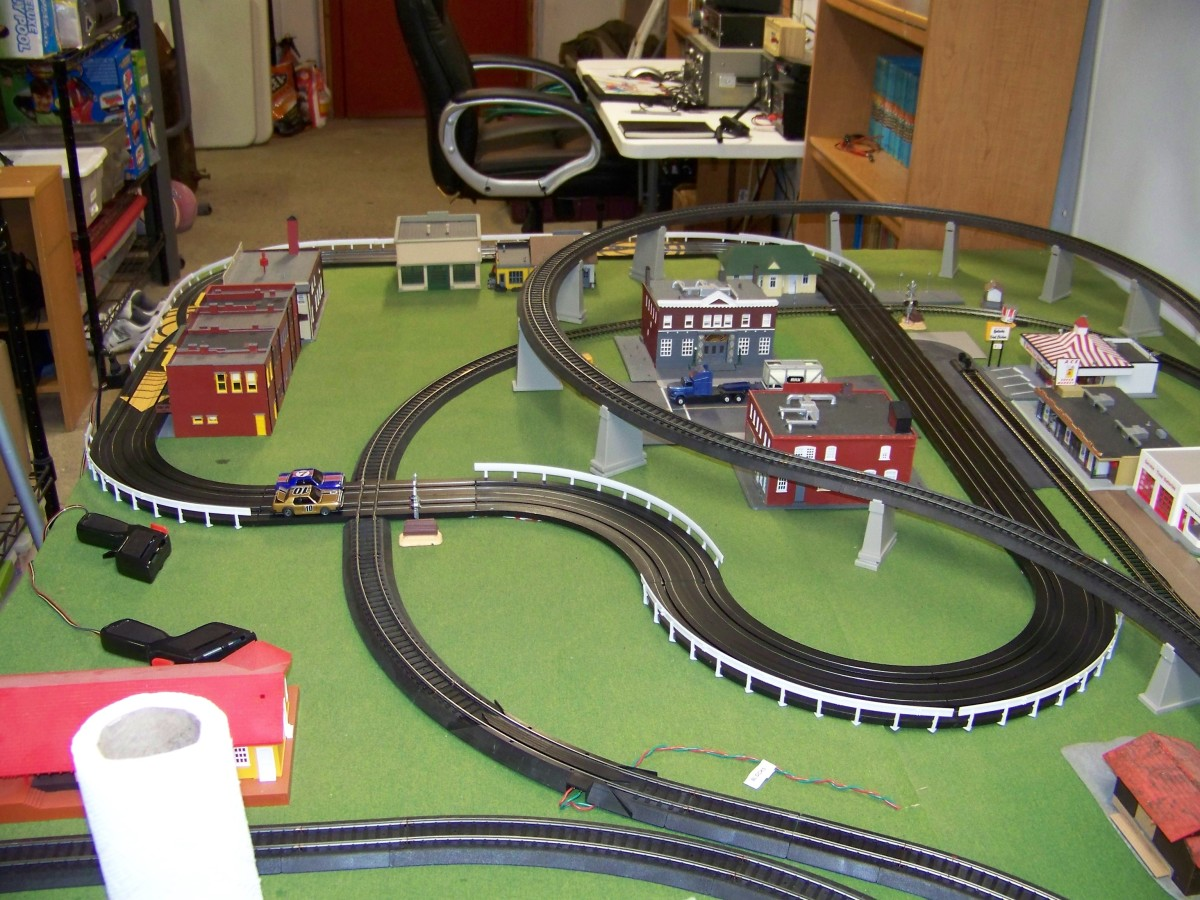 Try to beat the train with your slot car! Like-Like makes an adapter that allows to to create a slot car /  track intersection for just such fun!