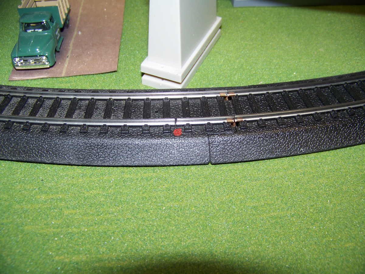 Sometimes, in both DC (Direct Current) and DCC (Digital Command Control) layouts, you have insulate track sections. I do this by cutting the track with a Dremel. Marking the spot with a red dot of paint will make it easier to find later.