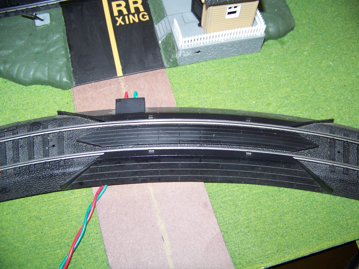 I had a bunch the rerailer track sections lying around from train sets I purchased. I insert these track throughout my layout to re-rail trains that may start to come derailed during operation.