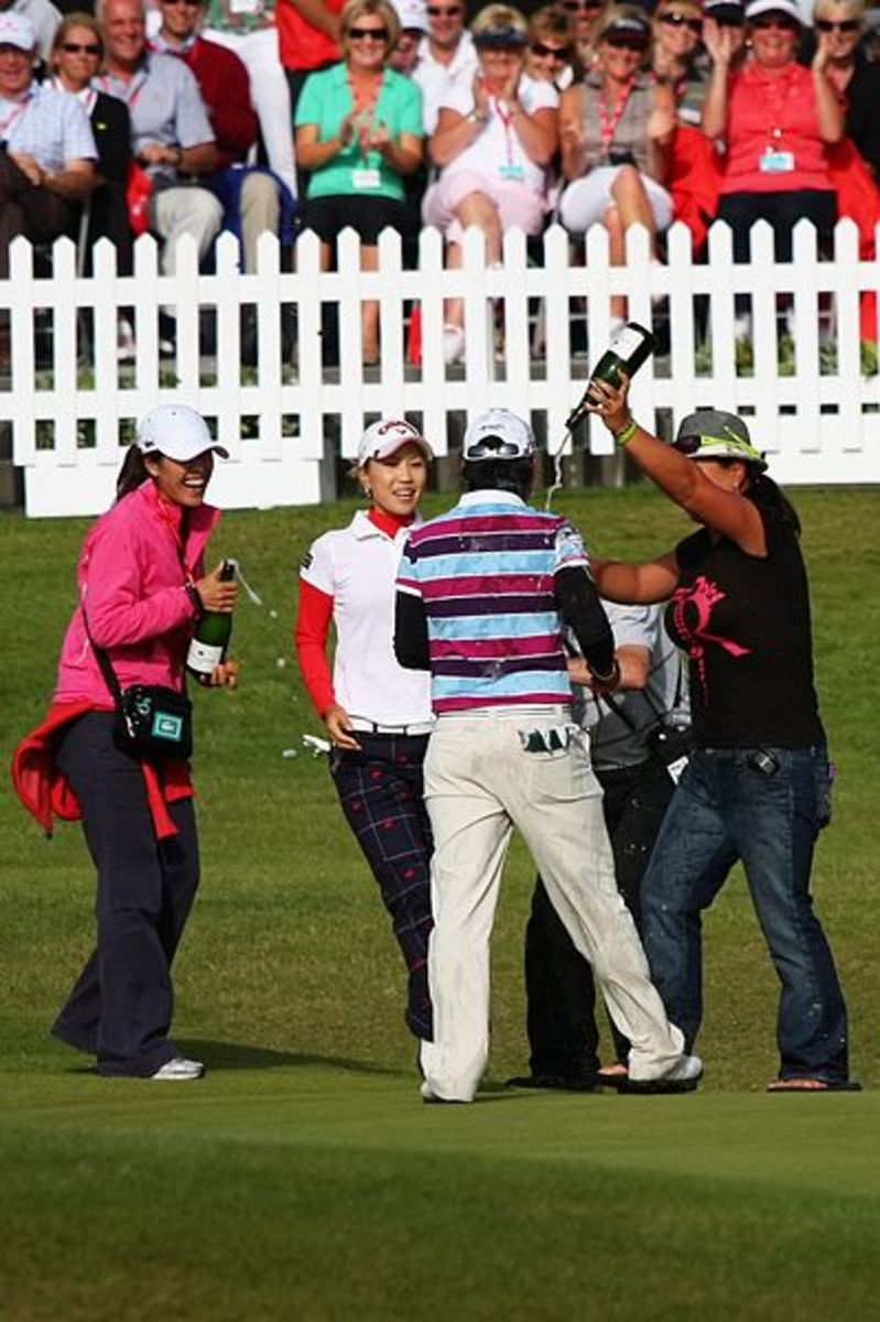 Champagne shower celebrating a golf victory.