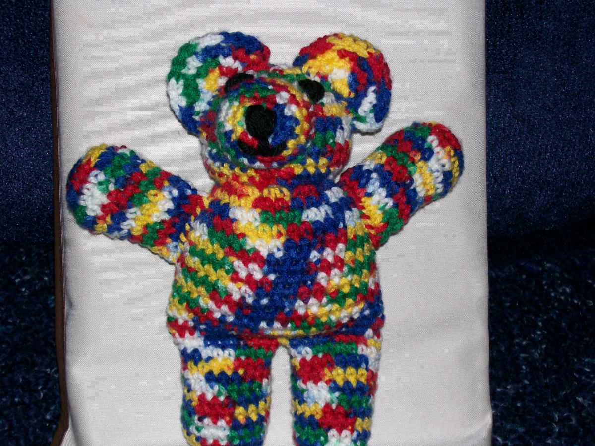 "Crocheted ""crayon"" color ombre yarn for a wild colored bear."