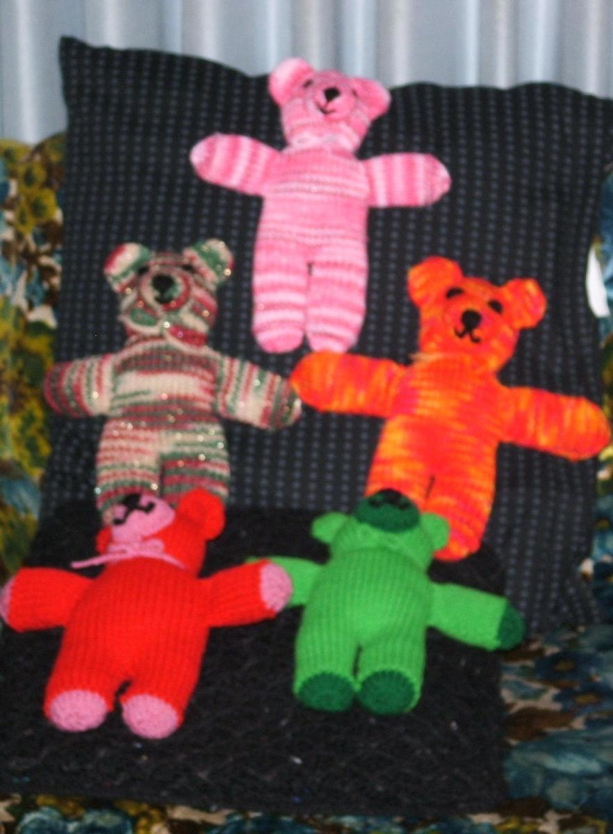 "All around 10-12"" tall, a variety of knit colorful teddy bears."