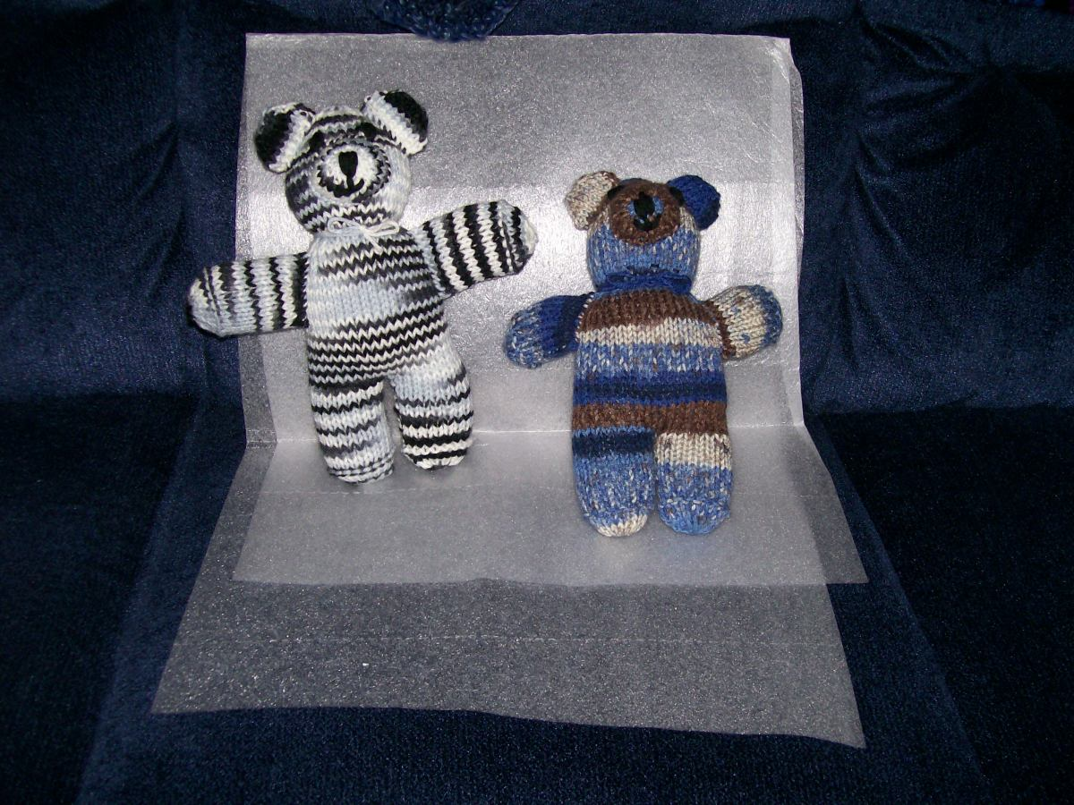 More knit bears to donate. Same self-striping yarn as crocheted bear, comes out different when knit.
