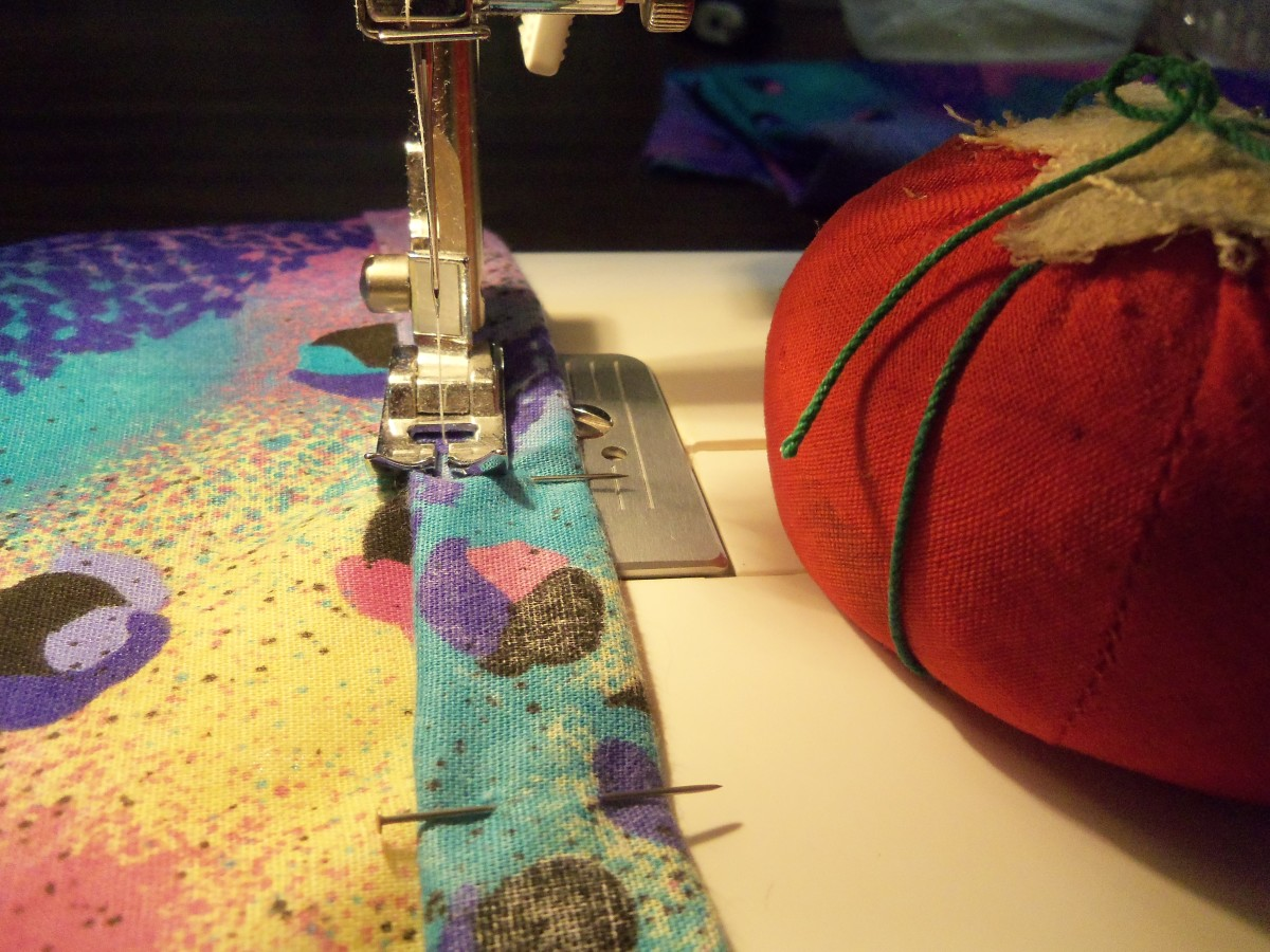 Remove pins right before the foot gets near it.  Make sure to put them in the pincushion as you remove them.