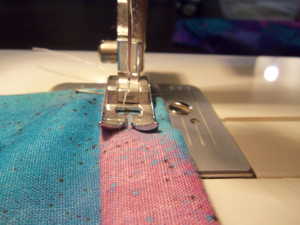 Sew one inch in and then reverse to the end.  Then go forward again slowly creating a straight stitch.