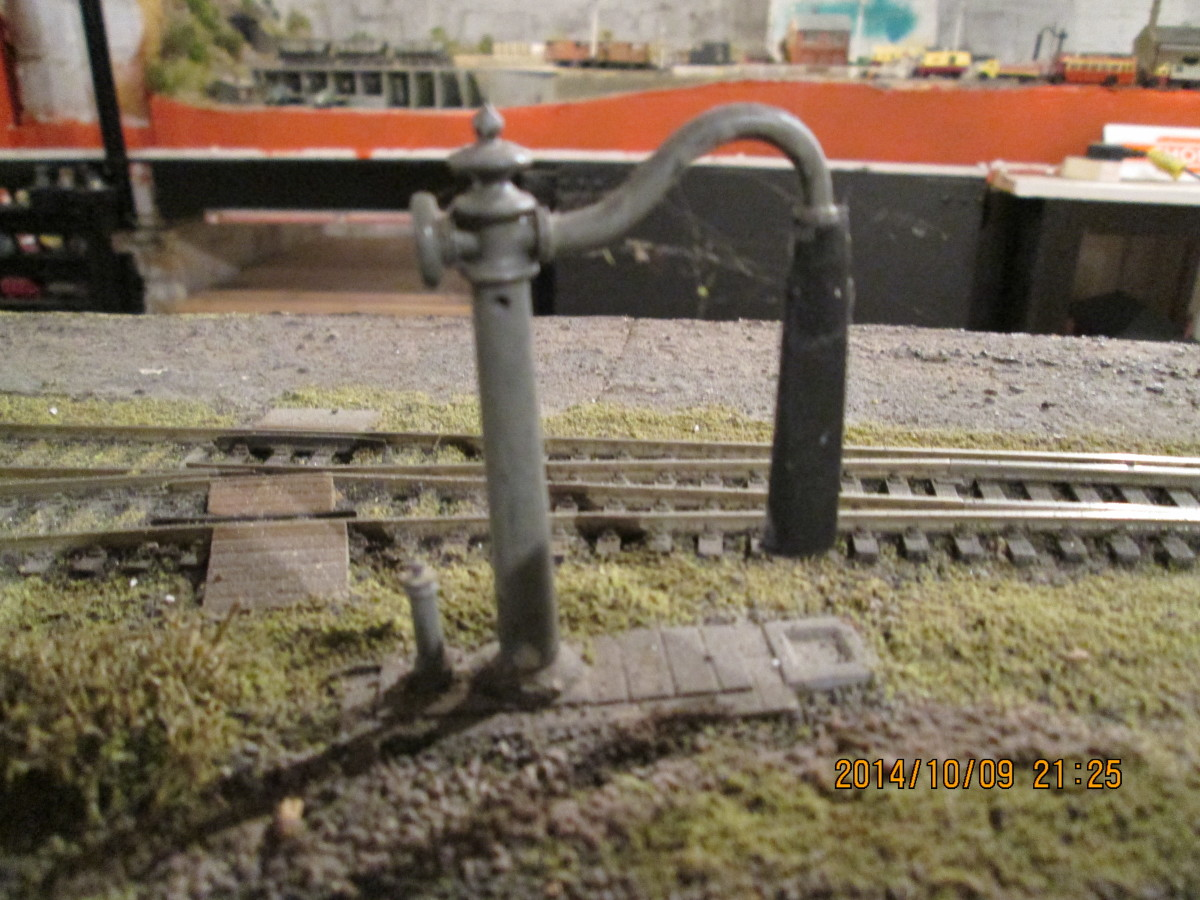 The (Mike's Models) North Eastern water crane is sited between the loop and platform road to allow a passenger or adjacent goods loco crew to replenish water tanks