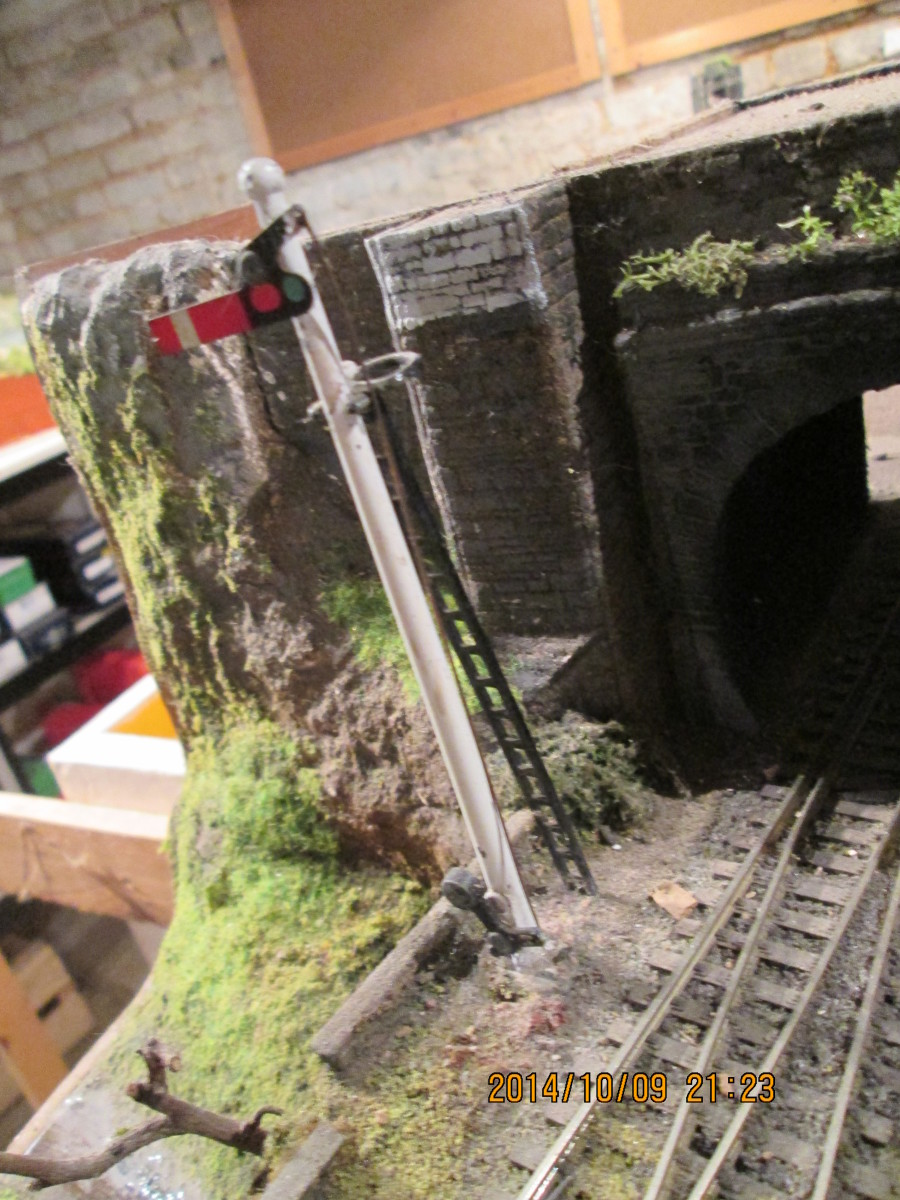 The Hornby starter signal at 'on' means a train could be due or the line is occupied - the tunnel entrance is boxed in to darken it, make it a touch more realistic