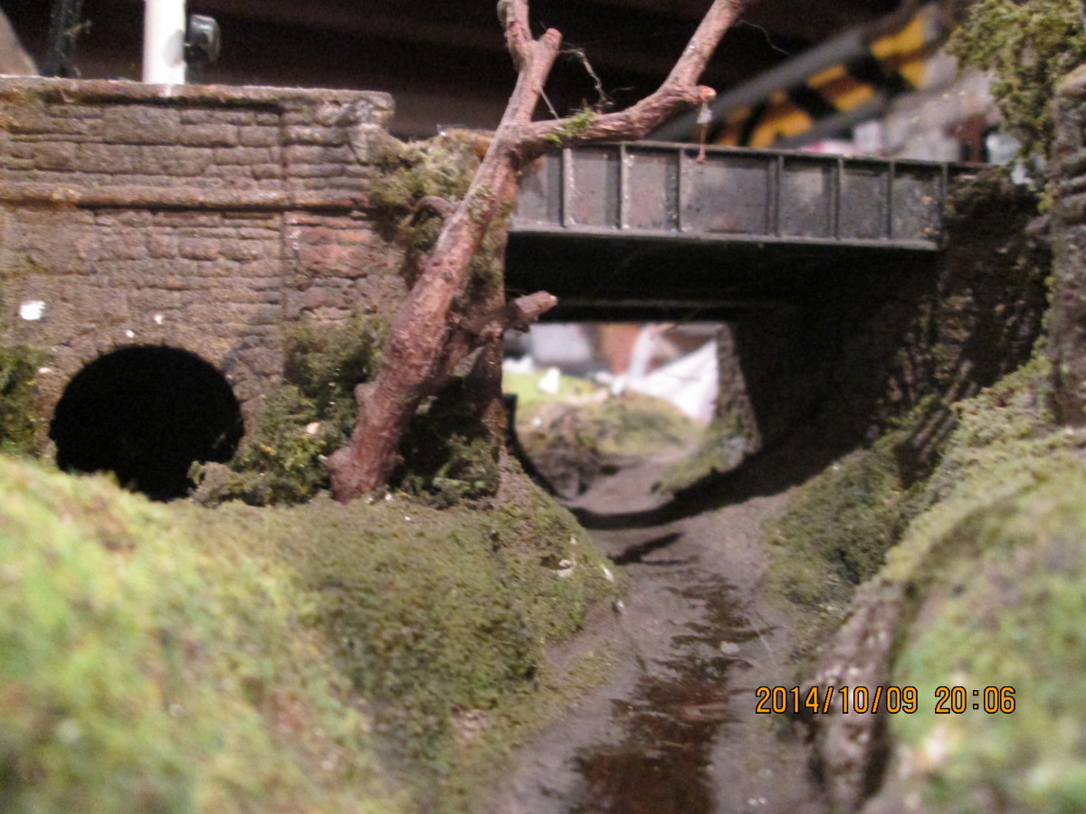 From the front, livestock underpass or 'cattle creep'behind that tree, the girder sidewall and abutments on the station side