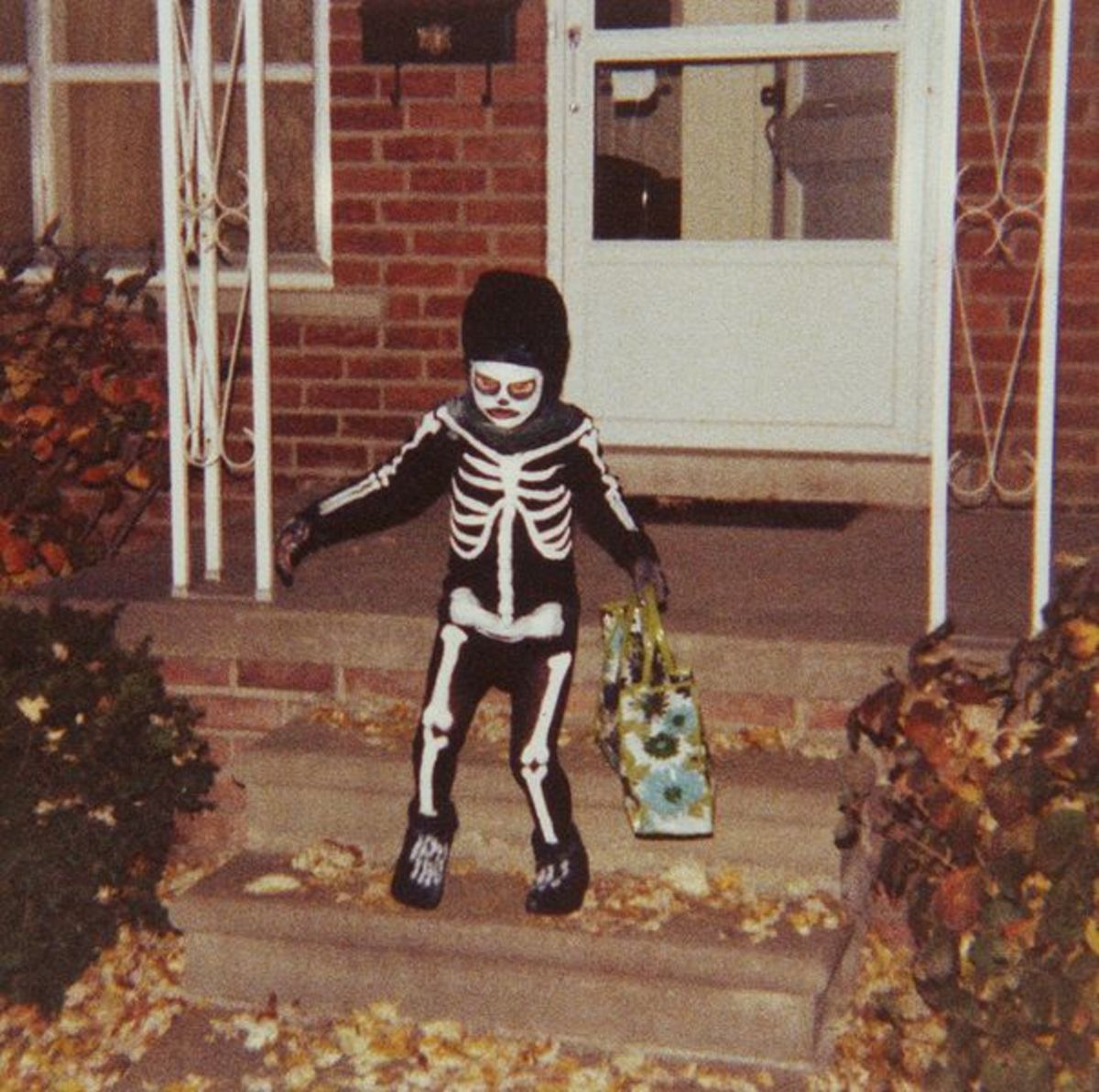 Small Trick or Treater in Spooky Costume Bears Away Spoils. This photo was taken in the US, but is reasonably typical of what might be seen in the UK .
