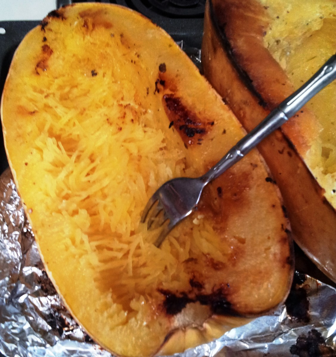 Pull a fork horizontally to achieve the best 'spaghetti' from your baked squash. Voila!