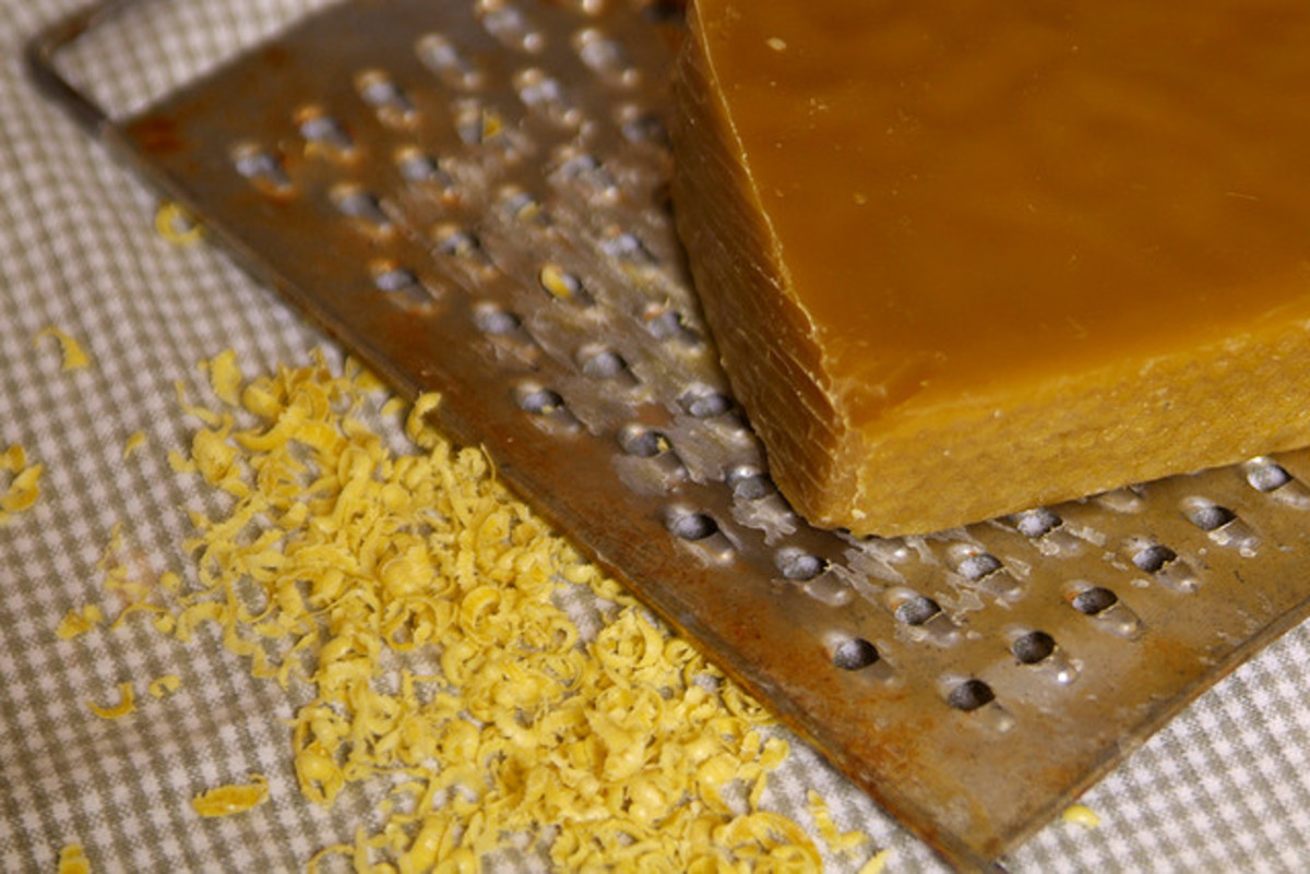 example of a bar of beeswax being grated