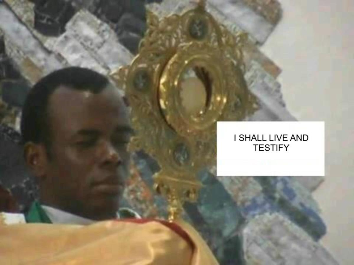 Rev. Fr. Ejike Mbaka carrying the Holy Eucharist during adoration. He is a man of God from Nigeria.