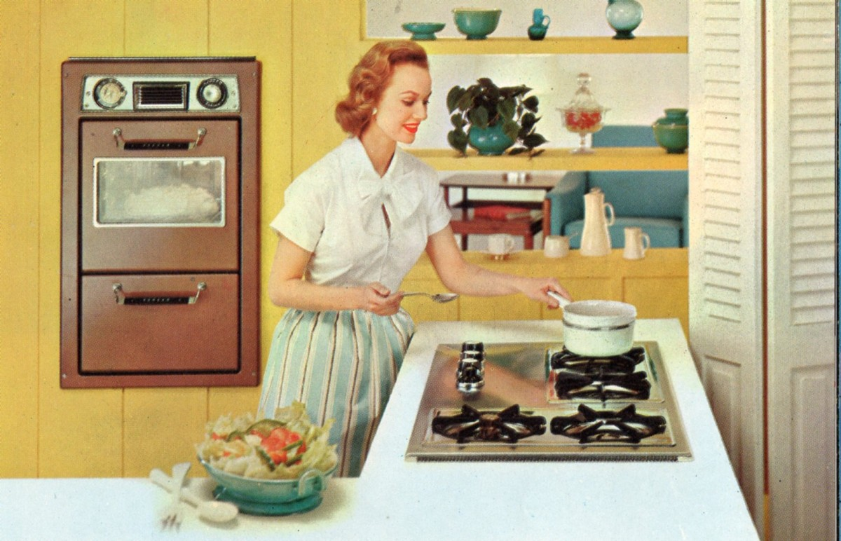 1950s Homemaker preparing dinner in kitchen