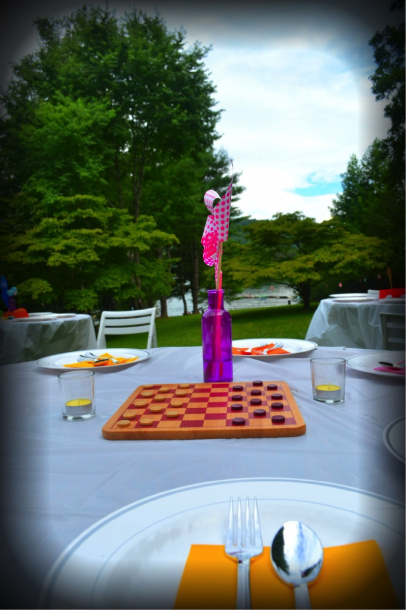 This table featured a classic, wooden Checkers board.