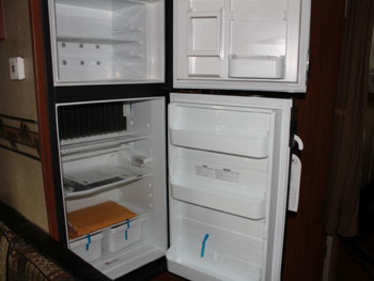 This is a full-sized typical 2-way RV Fridge with separate upper Freezer compartment.