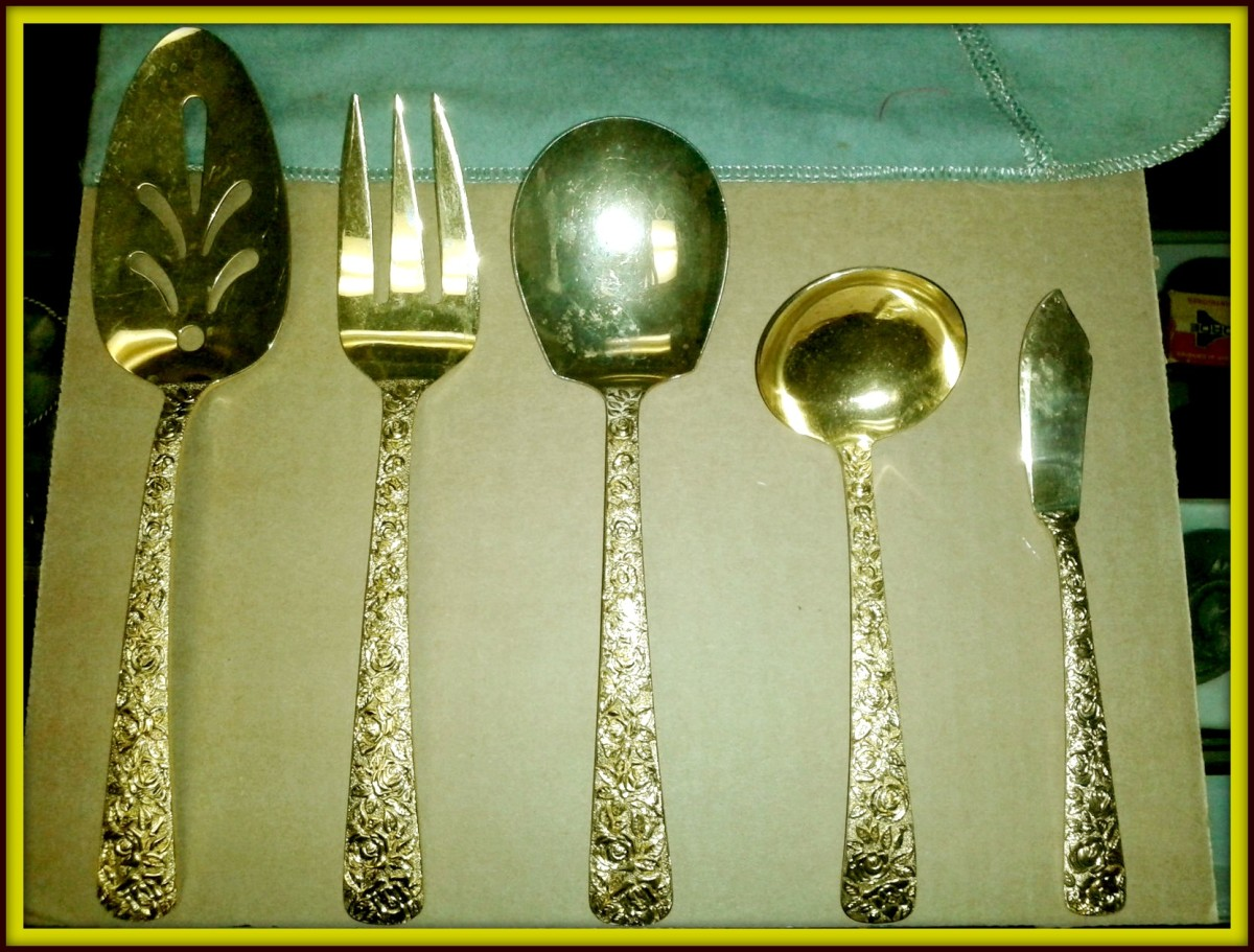 Cellini Romanesque Serving Set: This set includes Serving Fork, Server, Serving Spoon, Soup / Gravy Ladle, Butter Knife; they are stamped N.Y.M. Co., 1968.