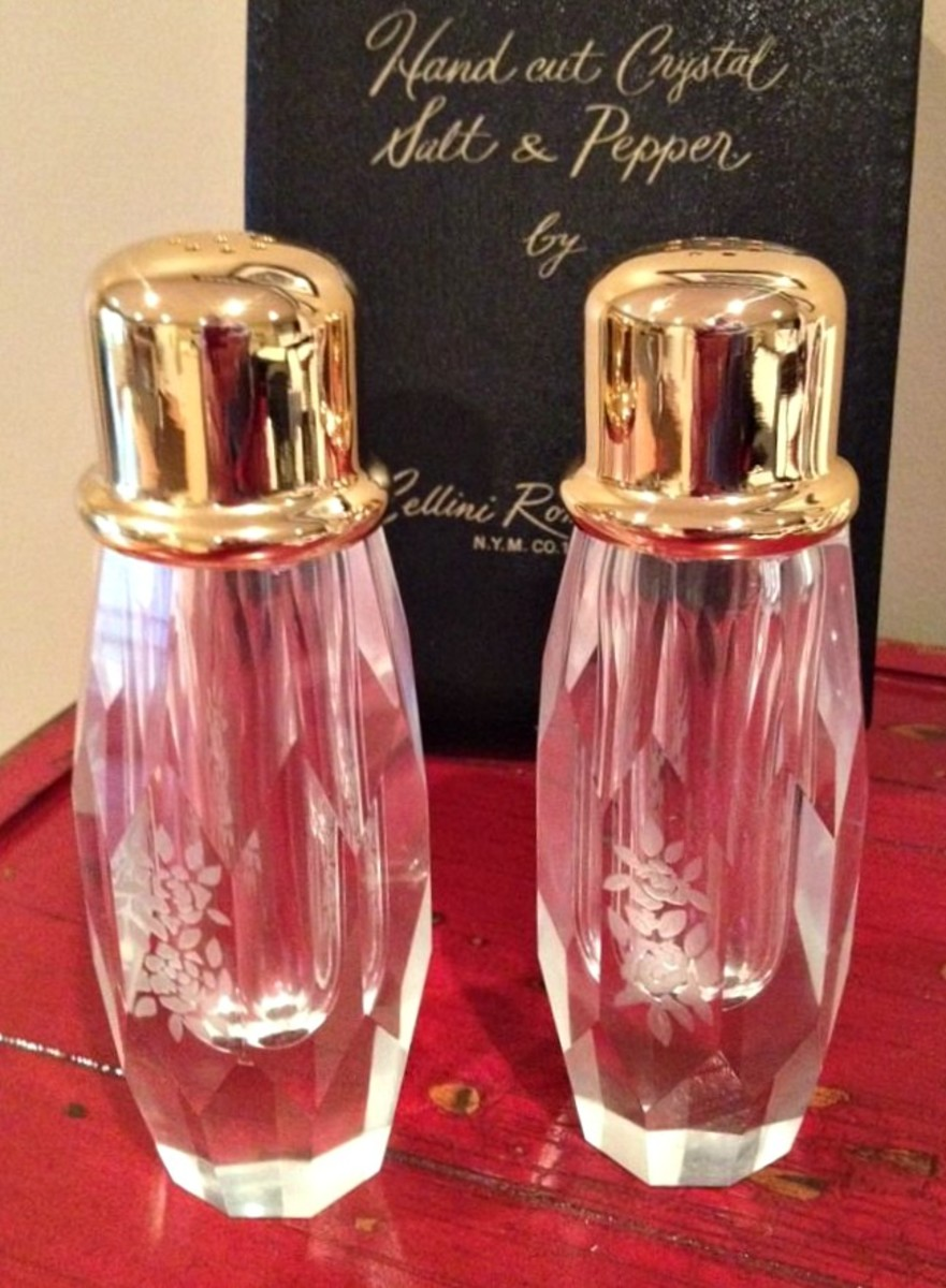 Vintage Cellini Romanesque hand cut crystal salt and pepper shakers with their original box. These salt and pepper shaker are hand cut crystal with pretty flower design on the sides.