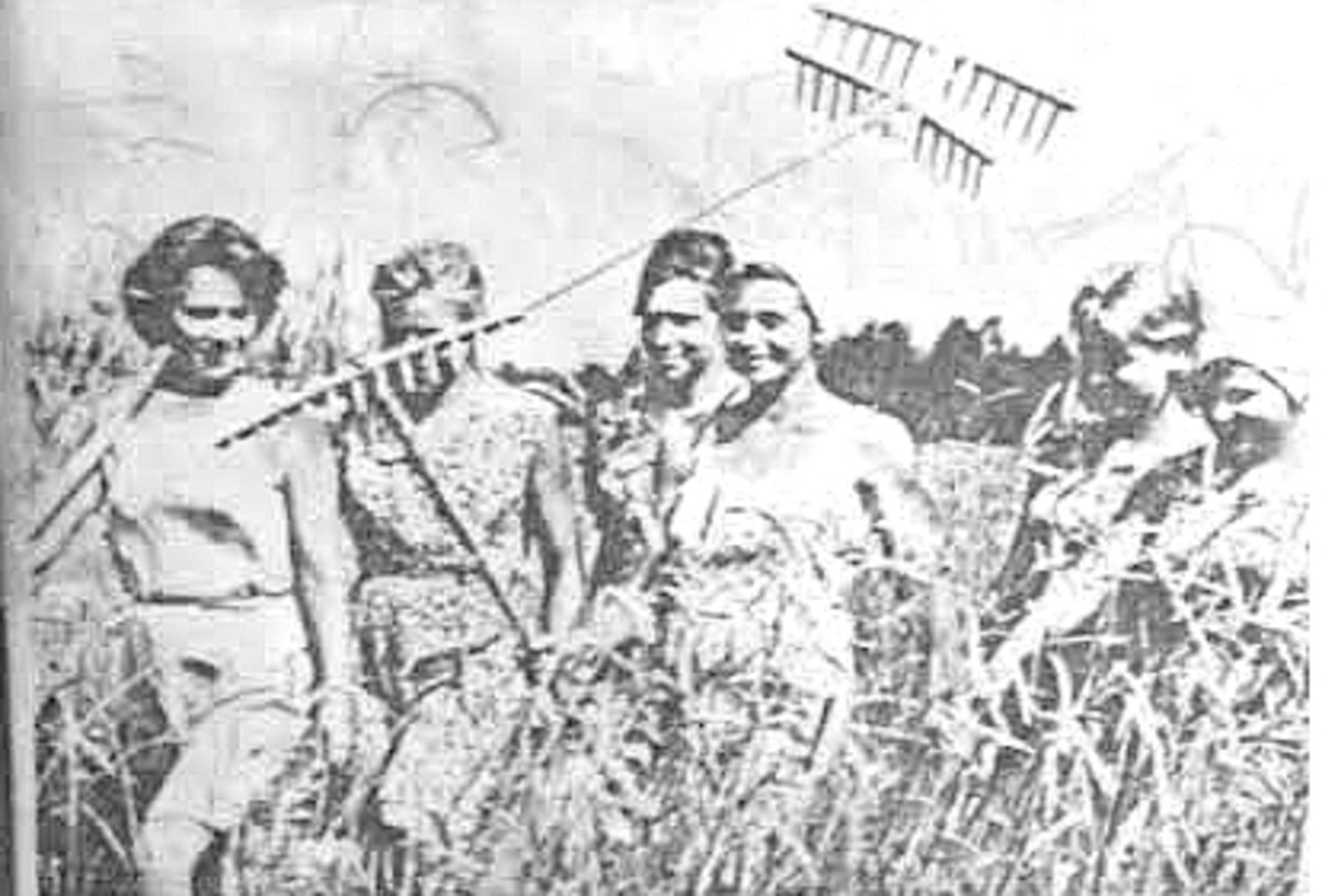 Soviet girls return from hay harvest - the one with a scarf on her head looks like me