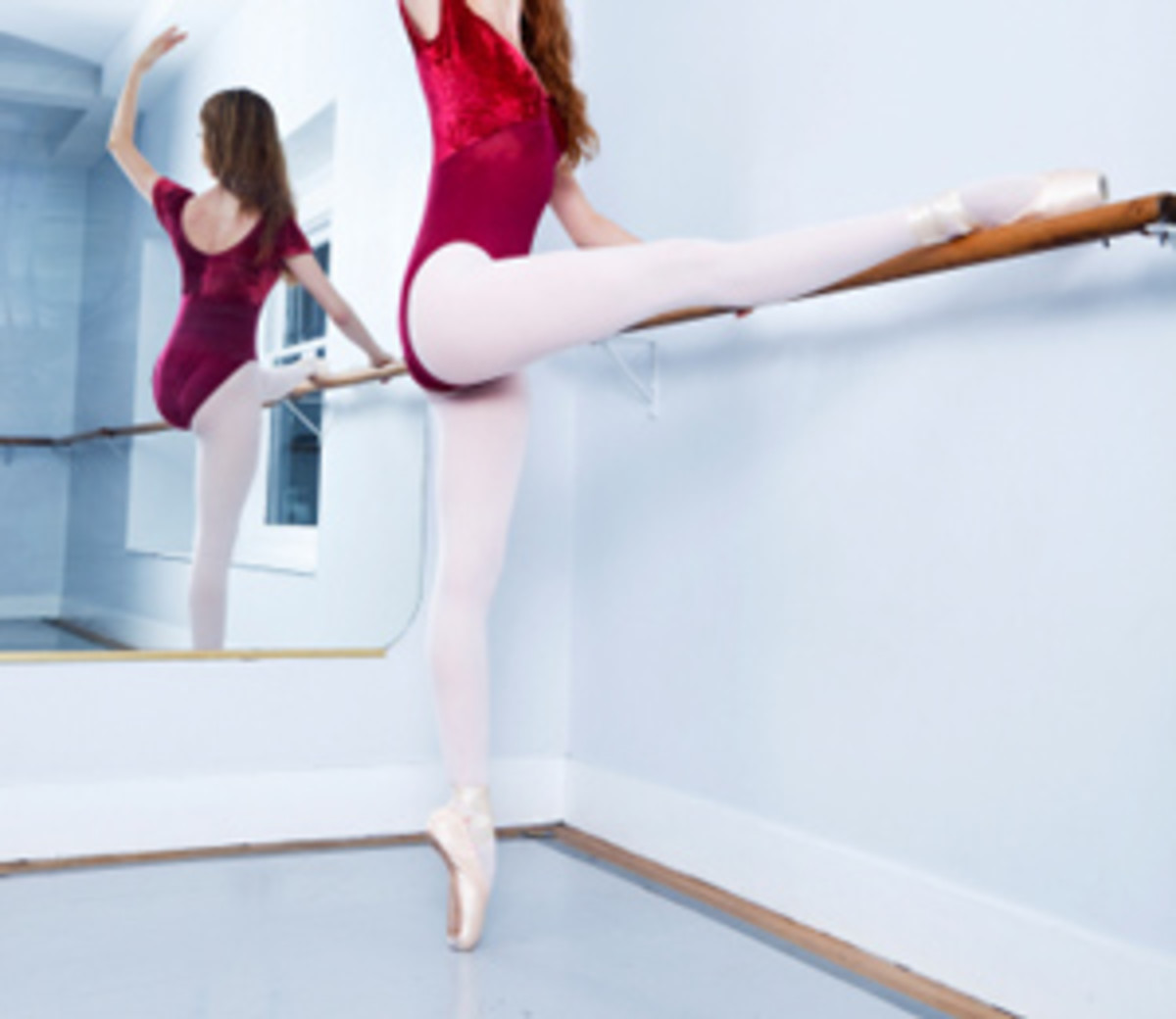 ballerina hamstring stretch illustrated using a ballerina bar for assistance