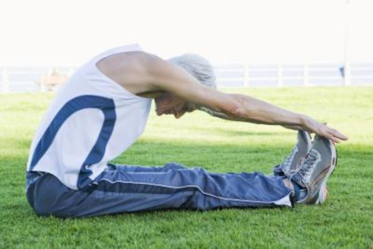 hamstring stretch performed by elite runner with hands over toes