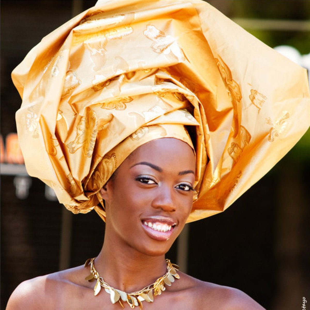 A beautiful golden colored Gele head tie