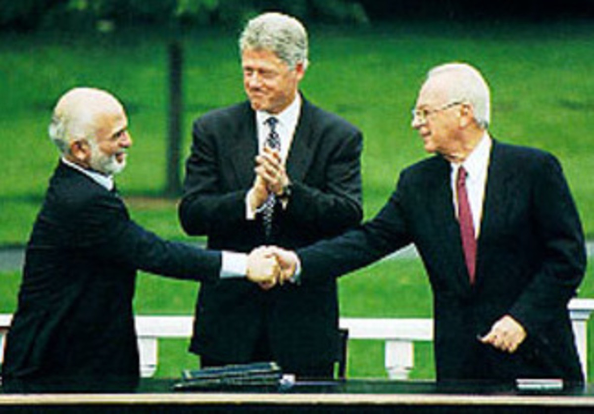 King Hussein I of Jordan, U.S. President Bill Clinton and Israel Prime Minister Yitzhak Rabin at Peace Negotiations in Washington D.C. on July 25, 1994