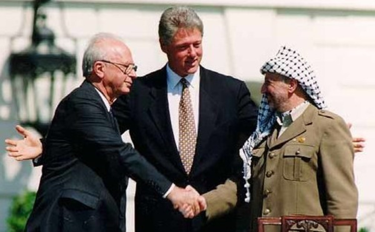 Israeli Prime Minister Yitzhak Rabin, U.S. President Bill Clinton, and PLO Chairman Yasser Arafat in Washington D.C., September 13, 1993