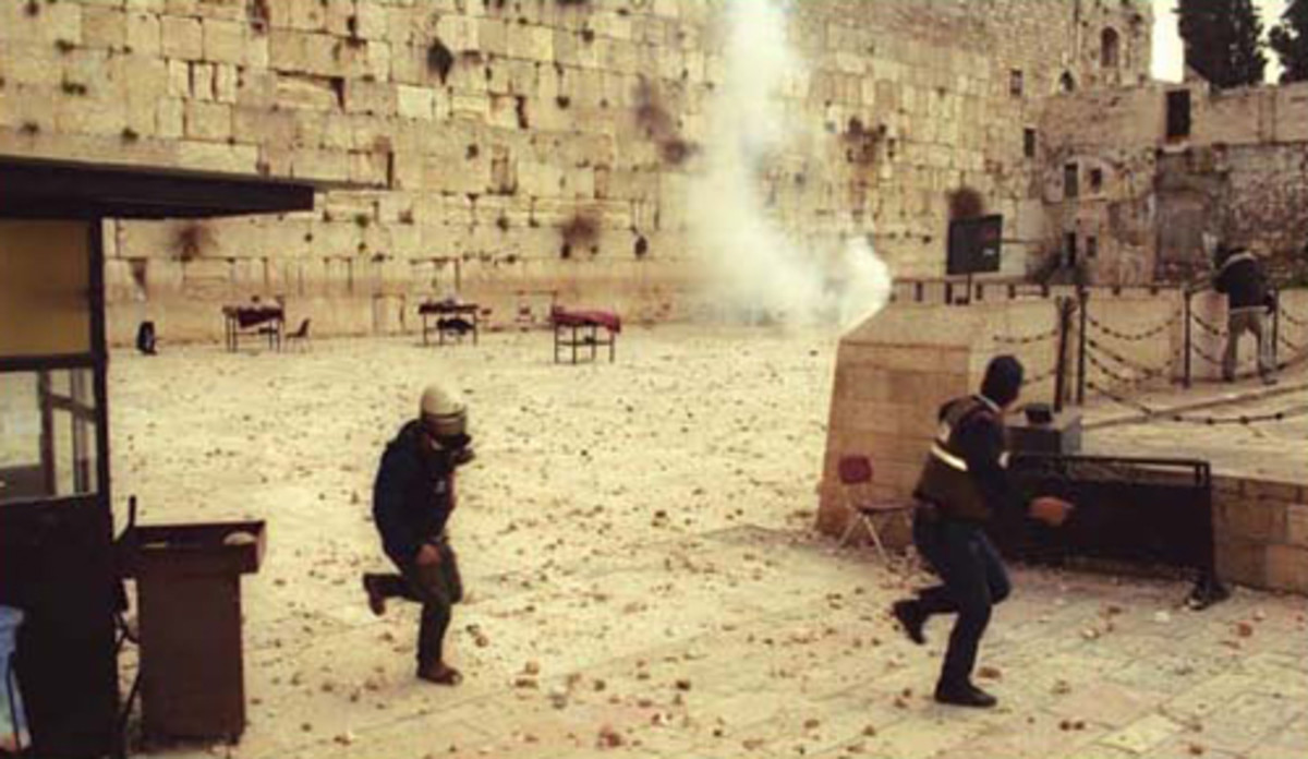 Western Wall Jewish Prayer Plaza Strewn with Rocks and Exploding Missiles on September 29, 2000