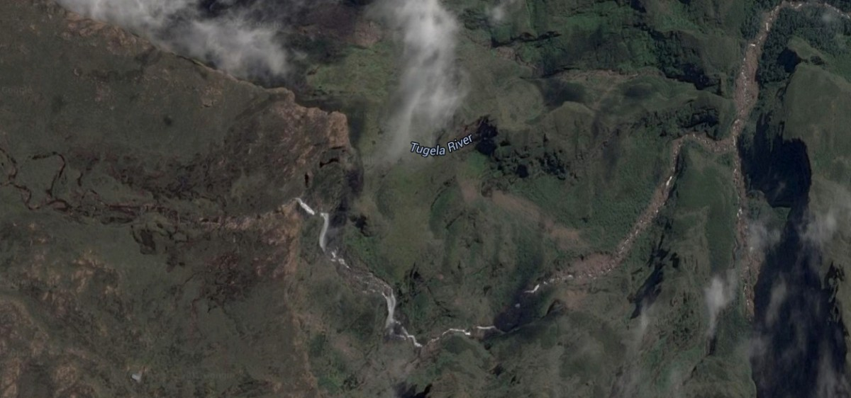 Tugela Falls on the Tugela River in South Africa. The upper part of the river is in the left of the picture, the falls are in the middle, and the lower falls continue off screen to the right.