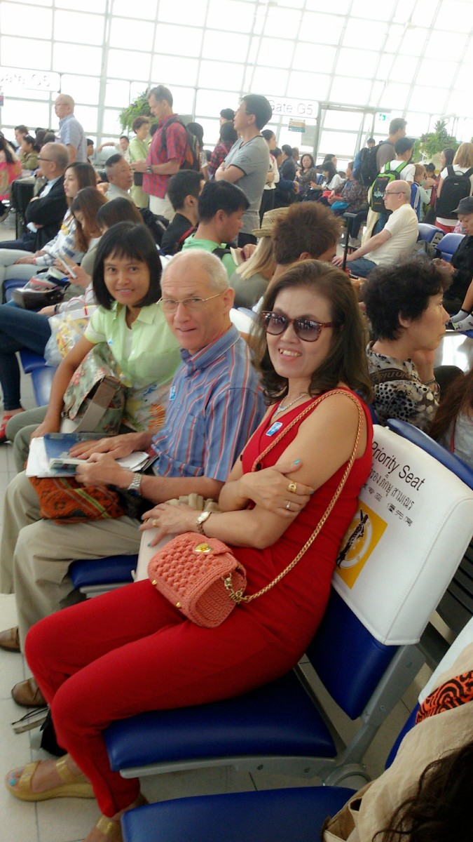Taken at Udonthani Airport on 04-13-15.  My wife is talking with my neighbor and his wife who accompanied us to Hong Kong.