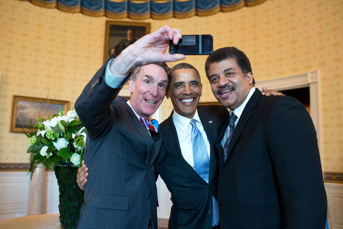 "President Barack Obama poses for a selfie with Bill Nye ""the Science Guy"", left, and Neil DeGrasse Tyson in the Blue Room prior to the White House Student Film Festival, Feb. 28, 2014. (Official White House Photo by Pete Souza)."
