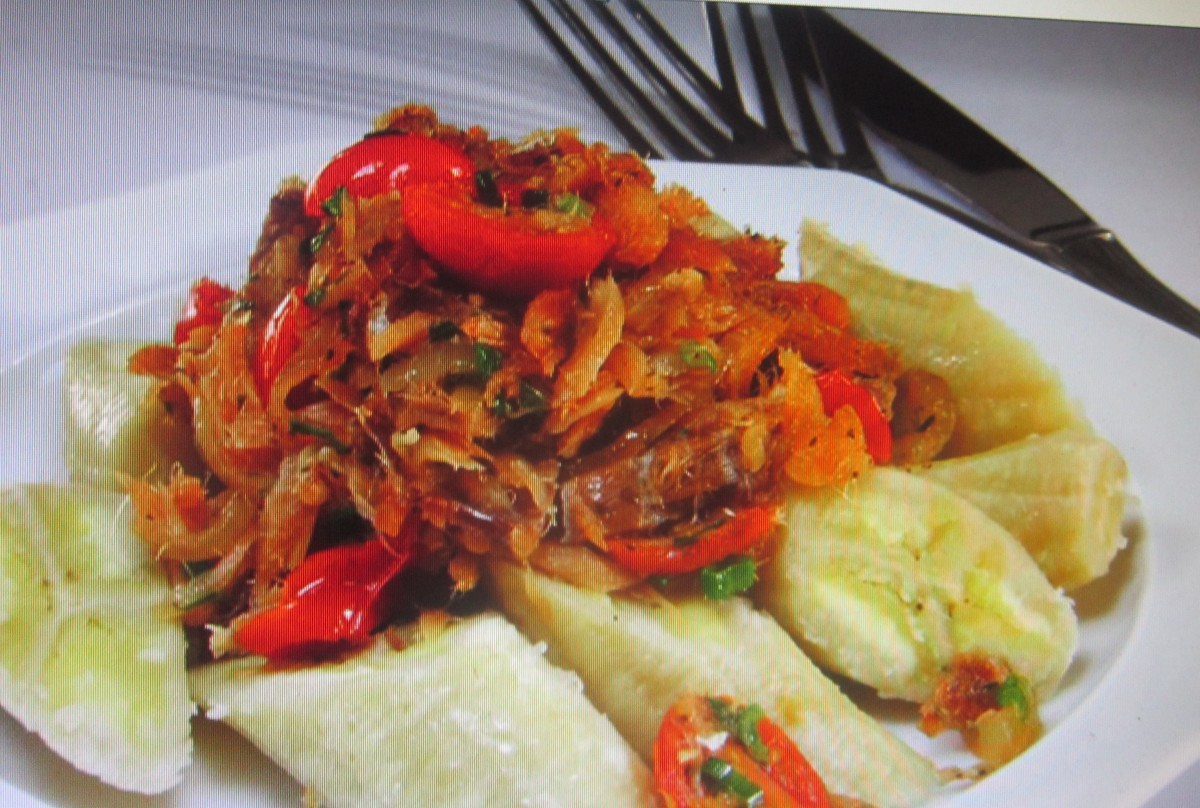 Boiled green banana served with saltfish.  Thanks to Cynthia Nelson and Tastes Like Home: My Caribbean Cookbook