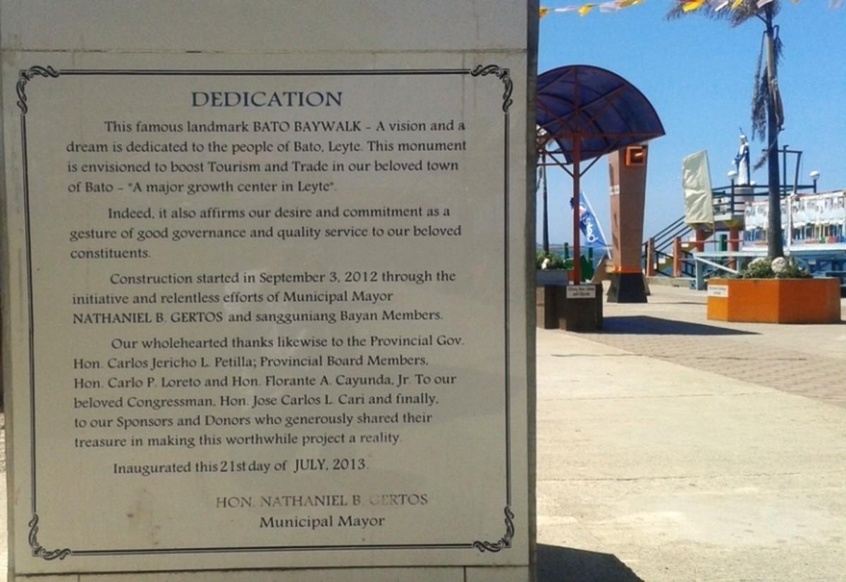 Bato Baywalk history signage.