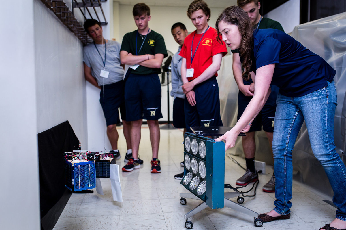 Students learn about the physics of heat on satellites.
