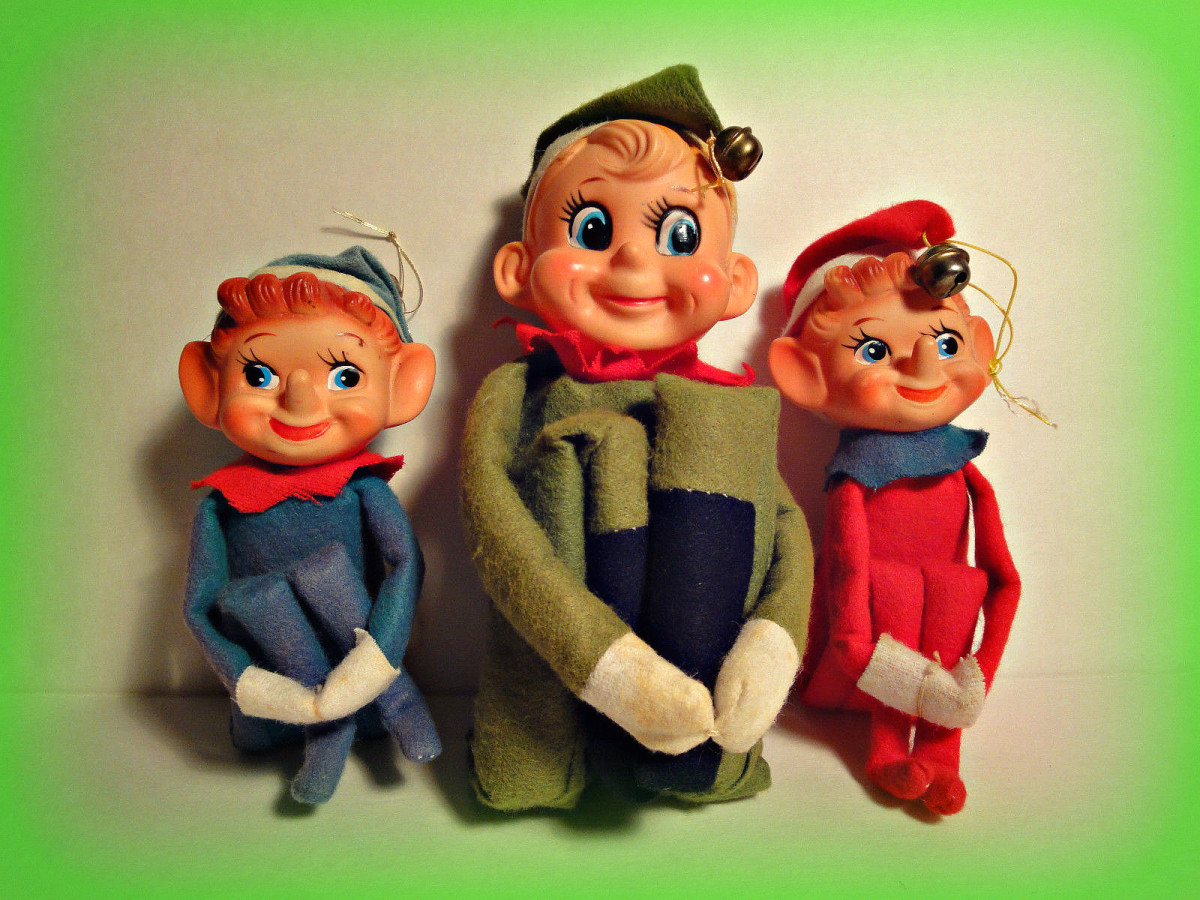 """Three happy Elf's, all three have bell's on the hat's.....They all have a different tag """" Made in Japan """" Their names are Blinky, Stinky, and Minky"""