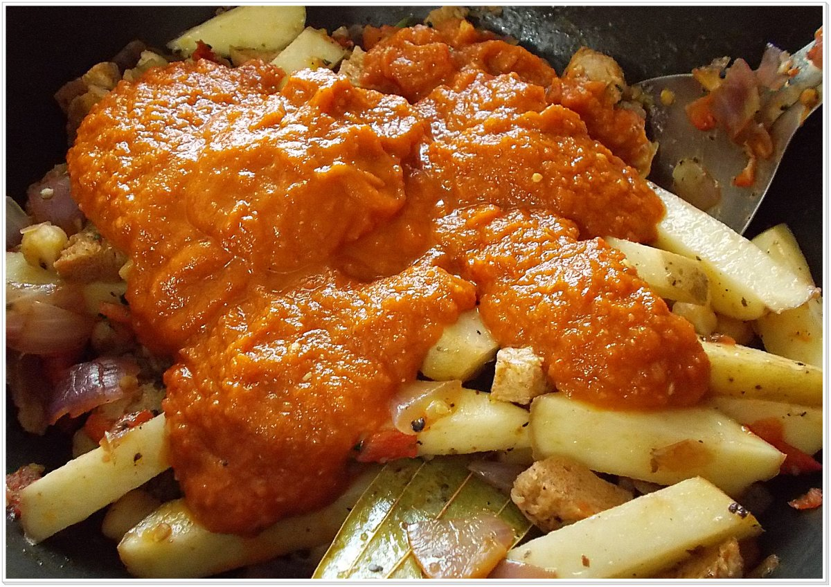Homemade tomato paste on top of the sauteed vegetables.