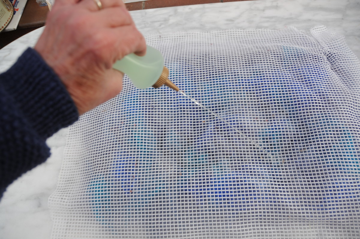 Cover with a small piece of curtain netting and wet with hot soapy water