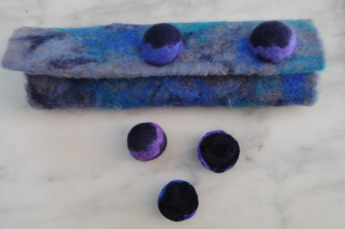 Cut the felt balls into half and sew on for decoration