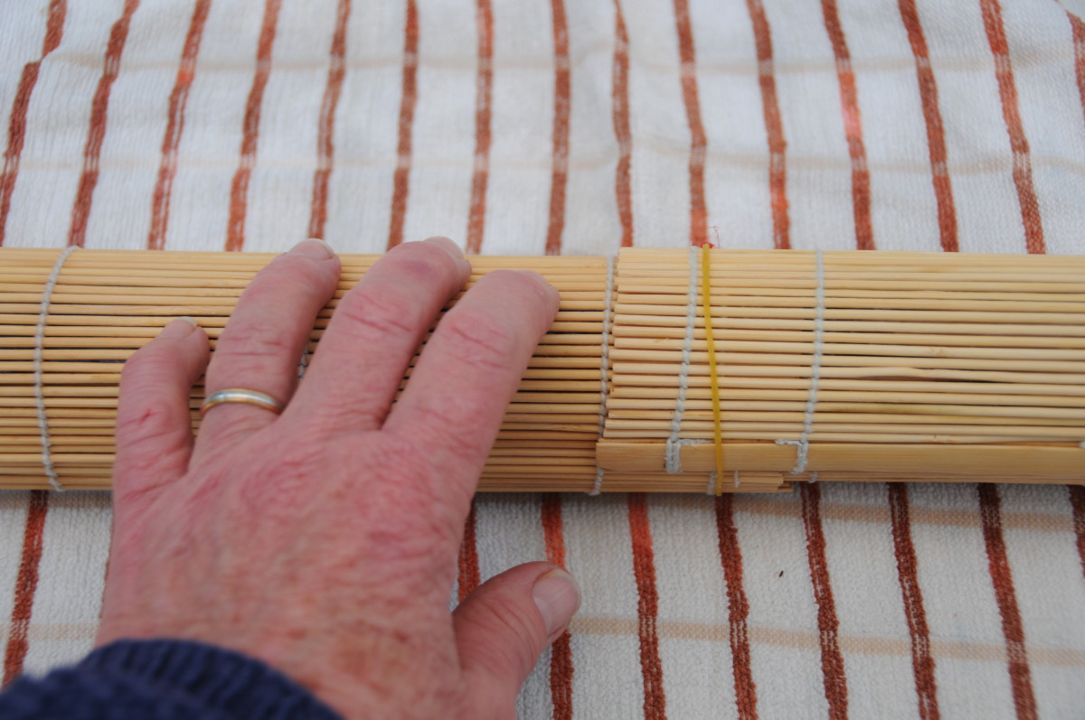 Rolling on a tea towel helps to soak up any additional moisture and makes it easier to roll the sushi mats.