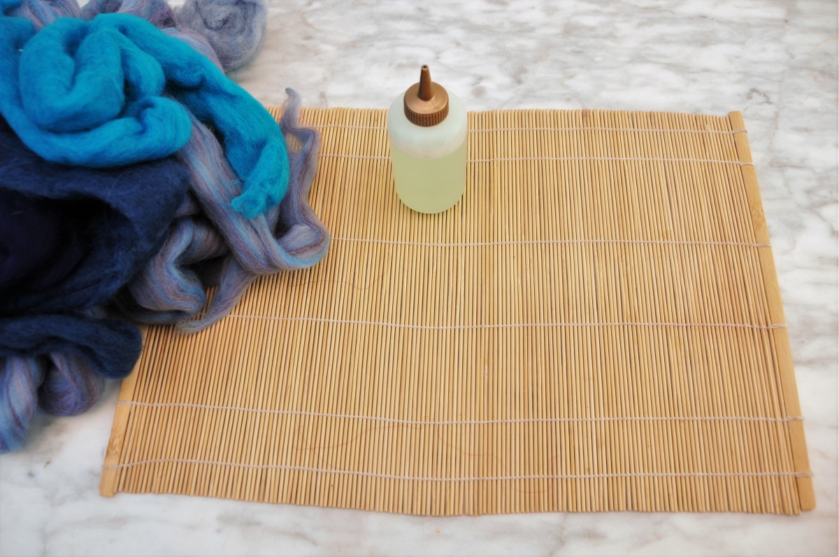 Sushi mat, hot soapy water and merino wool roving.