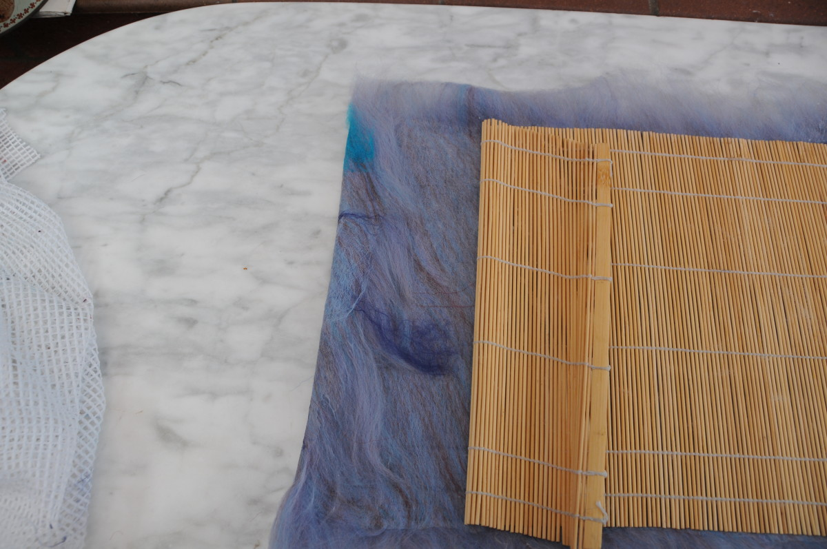 Fold the fibers in to match the size of the mat
