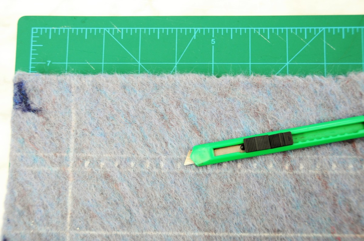 Supervise the cutting of felt with a blade cutter.  A small sharp pair of nail scissors will do the job just as well